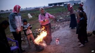 Syrian refugees at a makeshift refugee camp at Azaz in northern Syria, close to the Turkish border (17 December 2012)