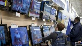 Customers buying televisions