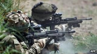Service personnel return fire in Afghanistan