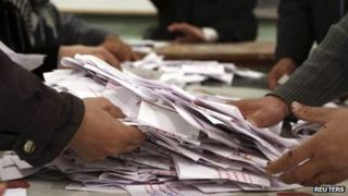 "Officials count ballots after polls closed during the final stage of a referendum on Egypt""s new constitution (22 December 2012)"