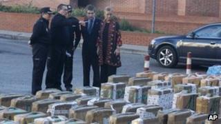 Madrid regional government delagate Cristina Cifuentes (right) and the chief of Spain's national police force, Ignacio Cosido (2nd right) look at part of a haul of hashish and marijuana in Madrid, Wednesday 26 Dec 2012