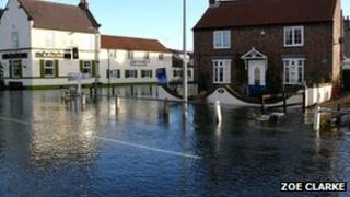 Flooded street at Burton Fleming