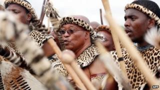 President Jacob Zuma with several people in traditional regalia (January 2010)