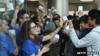 Customers entering an Apple store in China