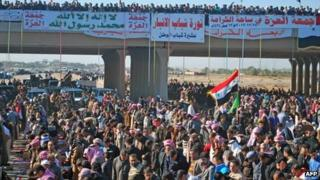 Sunni Iraqis pray during a demonstration calling for the release of prisoners they say were arrested on sectarian grounds in Ramadi, Anbar's provincial capital, on 28 December 2012