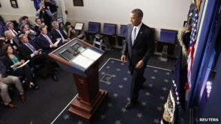 "President Barack Obama arrives at the lectern to deliver remarks after the House of Representatives acted on legislation intended to avoid the ""fiscal cliff"" at the White House, Washington DC, 1 January 2013"