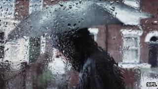 Man holding an umbrella