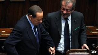 Silvio Berlusconi and Roberto Maroni in parliament (file pic, 2011)