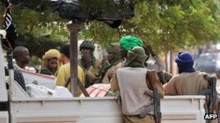 A photo taken on September 21, 2012 shows a group of armed Islamists gathered in the Malian city of Gao