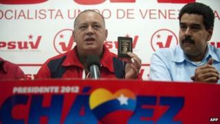 Diosdado Cabello (left) and Nicolas Maduro (right)