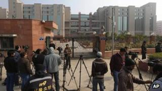 Television crew take positions in front of the Saket district court where the accused in a gang rape are being tried, in New Delhi, India, Monday, Jan. 7, 2013.