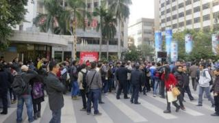 Demonstrators gather outside the headquarters of Southern Weekly newspaper in Guangzhou, Guangdong province, 7 January 2013
