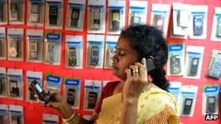 A woman talks on a mobile phone in India