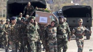 Indian army soldiers carry a coffin containing the body of a colleague who was allegedly killed by Pakistani soldiers