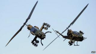 File picture of Japanese AH-1S helicopters on drill in Tokyo, 8 January 2012