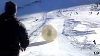 Denis Burakov and another man are seen inside a zorb in Dombai. Photo: 3 January 2013