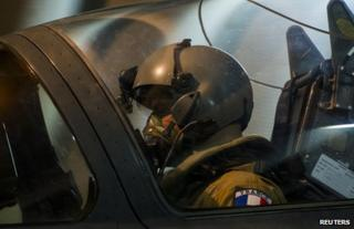 The pilot of a French Mirage 2000D jet sits in the cockpit at a base in Ndjamena, Chad, 12 January