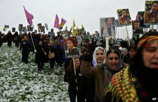Mourners gather at Villiers le Bel, north of Paris, for a memorial ceremony for the three Kurdish women shot dead last week, 15 January