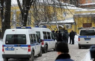 Police cars parked near the spot in Moscow where Aslan Usoyan was shot dead, 16 January