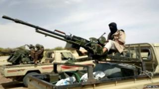 A handout photo of a video grab provided by the SITE Monitoring Service on 10 January 2013 and posted on 9 January on jihadist forums by a group calling itself al-Sahara Media Foundation reportedly shows al-Qaeda in the Islamic Maghreb fighters preparing for war in northern Mali