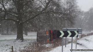 Truck on side in snow by B4030 in Middleton Stoney