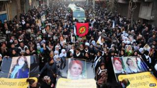 Thousands of people mark the funerals of the three Kurdish activists in the Turkish city of Diyarbakir