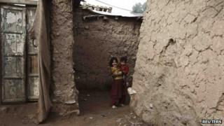 Children in slum on outskirts of Islamabad, Pakistan