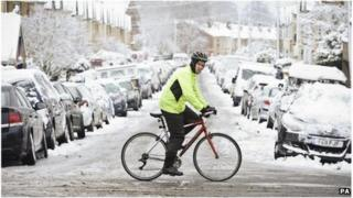 A cyclist in the snow