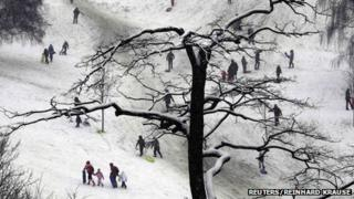People enjoy the snow at Greenwich Park in London January 20, 2013