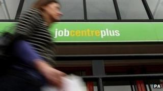 Woman walks past job centre