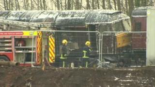 Fire crews at a derailed train in Salford