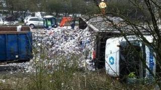 Overturned lorry on road