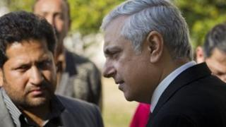 Irfan Qadir, right, attorney general of Pakistan speaks to reporters at the Supreme Court in Islamabad, Pakistan on Thursday, Jan. 24, 2013