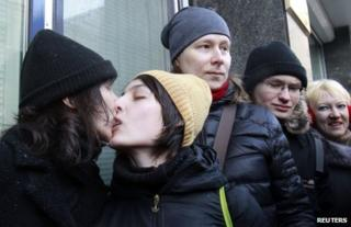 Gay rights activists kiss outside the State Duma in Moscow, 25 January