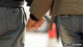 Couple holding hands (generic)