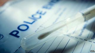 DNA swab with police evidence bag
