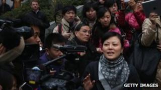 Official outside Guiyang court, China (28 Jan 2012)