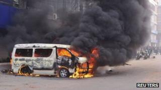 A minibus is set ablaze during a clash between Islamist activists and police in Dhaka January 28, 2013.