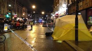 Police cordon around tent covering spot where man was hit by shop hoarding