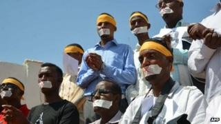 Somali journalists protest on Sunday 27 January 2013 in Mogadishu about the detention of their colleague in connection with a case of a woman who alleged she was raped by the security forces