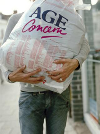 Man carrying Age Concern bundle