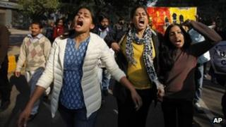 ndian women shout slogans during a protest march against gender discrimination and sexual violence in New Delhi, India, Saturday, Jan. 26, 2013.