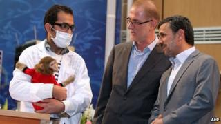 President Mahmoud Ahmadinejad (right) with the monkey that went into space in Tehran on 4/2/13
