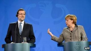 Angela Merkel (R) and Mariano Rajoy address a press conference at the Chancellery in Berlin on 4 February 2013