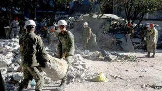 Mexican soldiers help clear debris. 4 Feb 2013