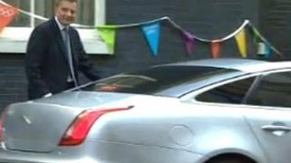 David Jones, pictured in Downing Street with his ministerial car last year