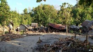 Damaged houses in the village of Venga in the Santa Cruz Islands region of the Solomon Islands on 6 February 2013