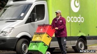 Delivery driver in front of Ocado van