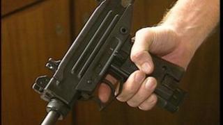 Person holding gun