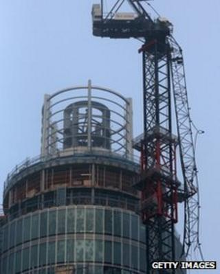 A damaged crane attached to St Georges Wharf Tower a